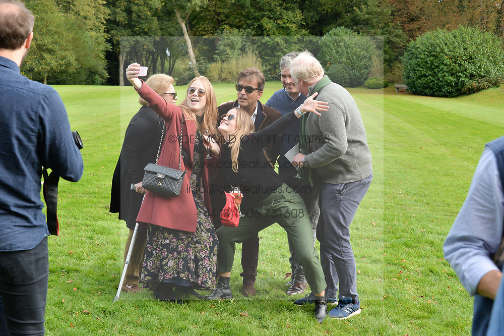 Veronica Henderson, Miranda Hadsley-Chaplin, James Henderson, Nick Henderson, Mark Hadsley-Chaplin, Ella Hadsley-Chaplin at Young Guns raising money for the fight against breast cancer trough Cancer Research UK held at EJ Churchill Shooting School followed by lunch at West Wycombe Park, England. 23 September 2017.