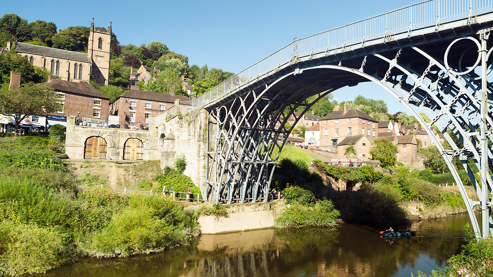 Iron Bridge, widely recognised as an iconic symbol of the industrial revolution, town of Ironbridge, Shropshire, United Kingdom, 2017-08-28.<br />