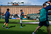 "Baltimore, Maryland - June 25, 2018: Seattle Mariners star Ichiro Suzuki warms up before the Mariners play the Orioles at Camden Yards in Baltimore Monday June 25, 2018.<br /> <br /> <br /> Seattle Mariners star Ichiro Suzuki goes through all the pre-game warm ups like any position player on the Seattle Mariners, before their game against the Baltimore Orioles at Camden Yard Monday June 25th  -- except his current position is ""Special Assistant to the Chairman,"" in the ball club's front office.<br /> He does everything an active player does except play. His new position in management forbids him from being in the dugout during game play, so he soaks up as much time with the players before the first pitch. <br /> <br /> CREDIT: Matt Roth for The New York Times<br /> Assignment ID: 30221475A"
