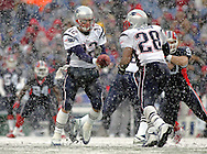 Tom Brady hands off to Corey Dillon in the heavy snow fall, New England Patriots @ Buffalo Bills, 11 Dec 05, 1pm, Ralph Wilson Stadium, Orchard Park, NY
