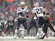 Tom Brady hands off to Corey Dillon in the heavy snow fall, New England Patriots @ Buffalo Bills, 11 Dec 05, 1pm, Ralph Wilson Stadium, Orchard Park, NY