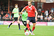 Wes York of York City (11) dribbles forward with the ball during the Vanarama National League North match between York City and Curzon Ashton at Bootham Crescent, York, England on 18 August 2018.