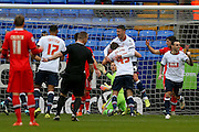 Bolton Wanderers forward Gary Madine congratulates Bolton Wanderers defender Robert Holding on his goal during the Sky Bet Championship match between Bolton Wanderers and Milton Keynes Dons at the Macron Stadium, Bolton, England on 23 January 2016. Photo by Simon Davies.