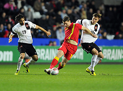 Sam Vokes (Burnley) of Wales  battles for the ball with Veli Kavlak (Besiktas) of Austria  and Sebatian Prodl (Werder Bremen) of Austria  - Photo mandatory by-line: Joe Meredith/JMP - Tel: Mobile: 07966 386802 06/02/2013 - SPORT - FOOTBALL - Liberty Stadium - Swansea  -  Wales V Austria - International Friendly