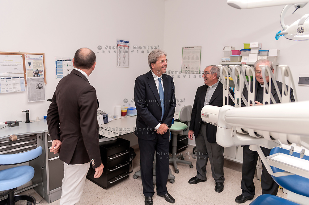 ROME, ITALY - SEPTEMBER 01: Italian PM Paolo Gentiloni visit dental centre during visit the Citadel of the Charity of the Diocesan Caritas of Rome on September 1, 2017 in Rome, Italy. Italian PM Paolo Gentiloni visited the Caritas to express the gratitude of all Italians to the world of volunteering, to those who work in favour of solidarity.