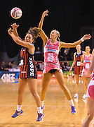 Erikana Pedersen of the Tactix competes for the ball with Renae Hallinan of the Thunderbirds during the ANZ Championship Netball game between the Mainland Tactix v Adelaide Thunderbirds at Horncastle Arena in Christchurch. 20th April 2015 Photo: Joseph Johnson/www.photosport.co.nz
