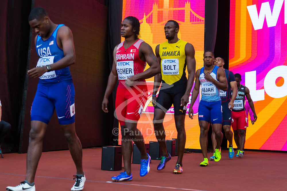 London, 2017-August-05. Christian Coleman, USA, leads Andrew Fisher of Bahrain, Usain Bolt of Jamaica and Chijindu Utah of Great Britain onto the track for the men's 100m semi final at the IAAF World Championships London 2017. Paul Davey.