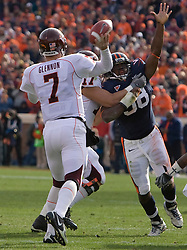 Virginia NT Nate Collins (98) puts pressure on Virginia Tech quarterback Sean Glennon (7).  The #8 ranked Virginia Tech Hokies defeated the #16 ranked Virginia Cavaliers 33-21 at Scott Stadium in Charlottesville, VA on November 24, 2007.