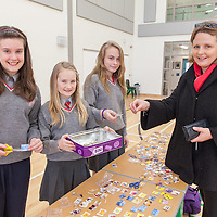 Eimer O'Reilly buying keyrings from Holly Gilligan, Emily Toner and Amee Marron