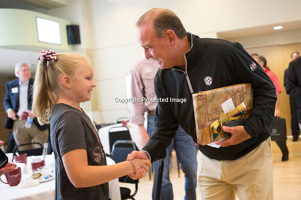 Mississippi State women's basketball head coach Vic Schaefer shakes hands with Kaylee Estes, 9, of Faulkner who attended the CDF Wake Up! Tupelo and Lee County event Friday morning with her grandfather David Horton at the Elvis Presley Birthplace. Kaylee traveled to Oklahoma City and Dallas see the team play in the NCAA tournament this past season.