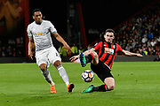 Lewis Cook (16) of AFC Bournemouth slides in to take the ball away from Anthony Martial (11) of Manchester United during the Premier League match between Bournemouth and Manchester United at the Vitality Stadium, Bournemouth, England on 18 April 2018. Picture by Graham Hunt.