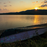 I traveled way up north to New Hampshire to Colebrook and North Country near the Canadian border and stopped at Third Connecticut Lake for a sunset picture. The boat in the foreground came in quite handy to make the composition more interesting and appealing to the viewer.      <br />
