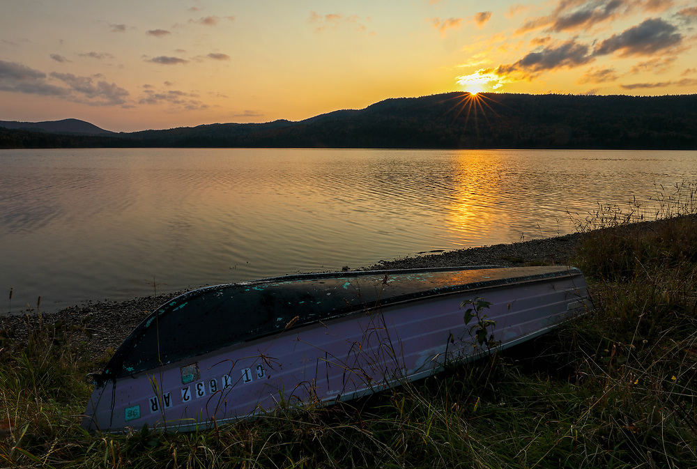 I traveled way up north to New Hampshire to Colebrook and North Country near the Canadian border and stopped at Third Connecticut Lake for a sunset picture. The boat in the foreground came in quite handy to make the composition more interesting and appealing to the viewer.      <br /> <br /> Northern New Hampshire Third Connecticut Lake sunset photography images are available as museum quality photography prints, canvas prints, acrylic prints or metal prints. Prints may be framed and matted to the individual liking and decorating needs at:<br /> <br /> https://juergen-roth.pixels.com/featured/third-connecticut-lake-juergen-roth.html<br /> <br /> All high resolution New England photography images from around all six states are available for photo image licensing at www.RothGalleries.com. Please contact me direct with any questions or request. <br /> <br /> Good light and happy photo making!<br /> <br /> My best,<br /> <br /> Juergen<br /> Prints: http://www.rothgalleries.com<br /> Photo Blog: http://whereintheworldisjuergen.blogspot.com<br /> Instagram: https://www.instagram.com/rothgalleries<br /> Twitter: https://twitter.com/naturefineart<br /> Facebook: https://www.facebook.com/naturefineart