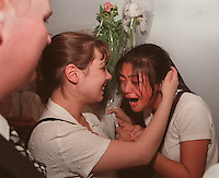 BOSTON- High School Drama Awards- . Globe Photo by Bethany Versoy. Christina Lim, right, bursts into tears after learning that her drama group from Reading High School were the winners of the State High School Drama Festival.RESTRICTED USE.NOT FOR REPBULICATION WITHOUT EXPLICIT APPROVAL FROM DIRECTOR OF PHOTOGRAPHY.