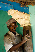 Builder working on old house in Muslim quarter of in Nagaipattinam.