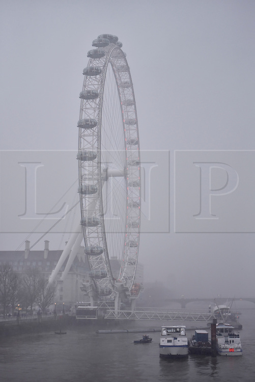 "© Licensed to London News Pictures. 18/03/2018. LONDON, UK.  The view of the London Eye from Hungerford Bridge is obscured by a late afternoon blizzard as the mini ""beast from the east"" weather system continues to bring frigid weather to the UK.  Photo credit: Stephen Chung/LNP"