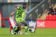 Forest Green Rovers Ebou Adams(14) is tackled by  Exeter City's Aaron Martin(5) during the EFL Sky Bet League 2 match between Exeter City and Forest Green Rovers at St James' Park, Exeter, England on 12 October 2019.