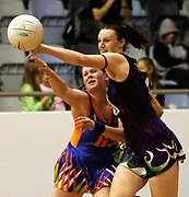 Netball. Melbourne Kestrels v Melbourne Phoenix at the State Netball Centre. Caitlin Thwaites has the ball knocked away by Bianca Chatfield.