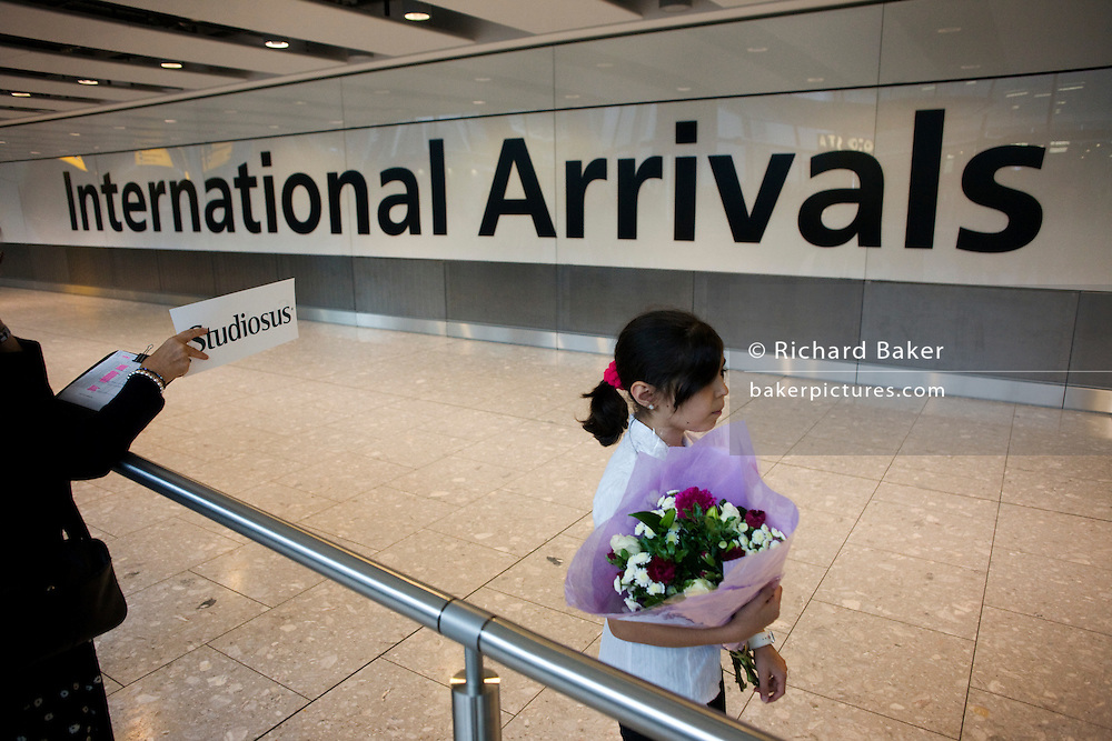 Awaiting loved-ones in International Arrivals concourse at Heathrow's terminal 5.
