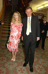 RICHARD & BASIA BRIGGS at a private view of the forthcoming sale 'Property from the collection of HRH The Princess Margaret, Countess of Snowdon' and a private view of art by Marina Karella Princess Michael of Greece, held at Christie's, 8 King Street, London SW1 on 12th June 2006.<br /><br />NON EXCLUSIVE - WORLD RIGHTS