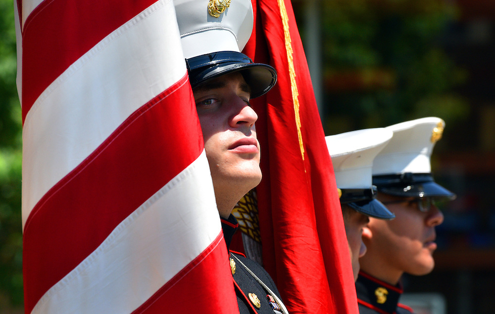Marine Sgt. Michael Pastore holds the American Flag at the end of the Kingston/ Forty Fort Memorial Day Darade.