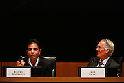 Rob Means, right, listens to Rajeev Madnawat's response during the Milpitas City Council Forum at Milpitas City Hall in Milpitas, California, on October 9, 2014. (Stan Olszewski/SOSKIphoto)
