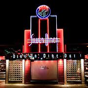 Neon lights at Silver Diner at night