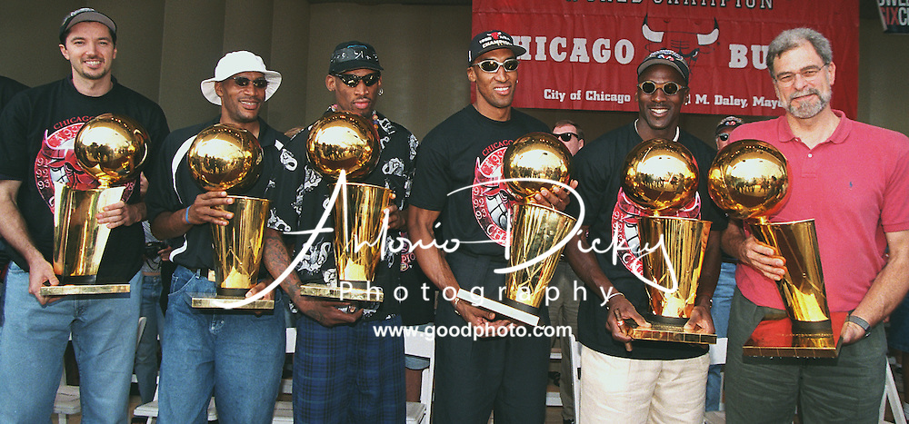 Chicago Bulls basketball team with their 6 championship trophys