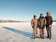 Castle Semple, Lochwinnoch in East Renfrewshire, Scotland. .Locals take advantage of the frozen loch to play ice hockey, ice skate or take an afternoon walk across the ice..Left to right George Frew, Jim Allan and Gorman McGhee.