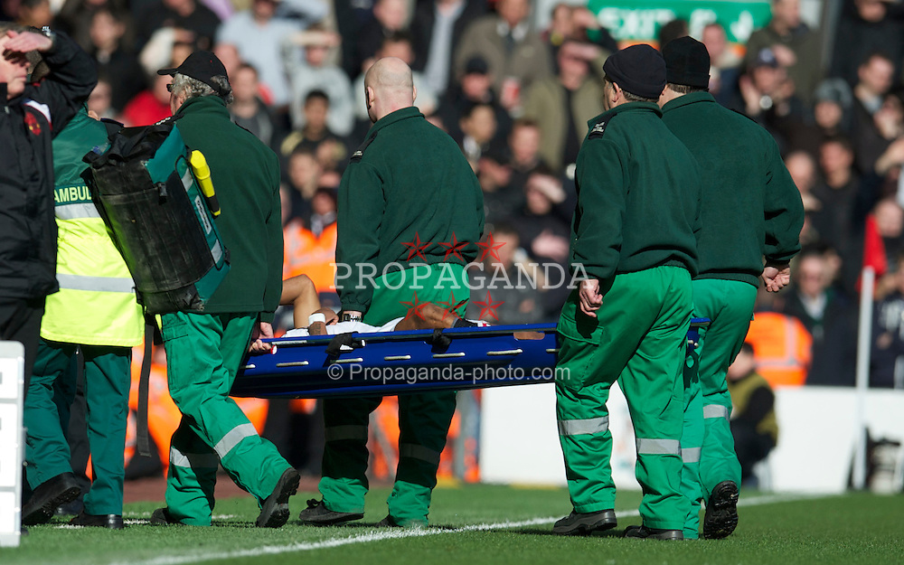 LIVERPOOL, ENGLAND - Sunday, March 6, 2011: Manchester United's Nani is carried off on a stretcher with a gash to his shin, amazingly the player was not wearing any protective shin pads, during the Premiership match against Liverpool at Anfield. (Photo by David Rawcliffe/Propaganda)