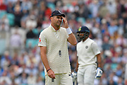 James Anderson of England looks to have a sore head during day 3 of the 5th test match of the International Test Match 2018 match between England and India at the Oval, London, United Kingdom on 9 September 2018.