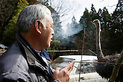 Naoto Matsumura takes care of pets and other animals left behind in the government-imposed no-go zone about 10 km from the Fukushima Daiichi Nuclear Power Plant in Tomioka, Fukushima  Prefecture, Japan on 01 Mar. 2012. . .Photographer: Robert GilhoolyNaoto Matsumura looks at an ostrich that is among the  pets and other animals he has been caring for since they were left behind in the government-imposed no-go zone about 10 km from the Fukushima Daiichi Nuclear Power Plant in Tomioka, Fukushima  Prefecture, Japan on 01 Mar. 2012. . .Photographer: Robert Gilhooly