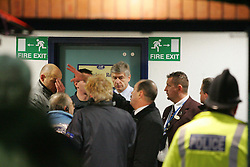 WIGAN, ENGLAND - TUESDAY, JANUARY 10th, 2006: Arsenal's manager Arsene Wenger chats with referee Howard Webb (L) and the stadium manager after the floodlights failed during the League Cup match at the JJB Stadium. (Pic by David Rawcliffe/Propaganda)