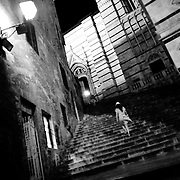 A young girl is walking the stairs to the duomo, Plazza del Campo, in the medieval city of Siena, Toscana. Italy.