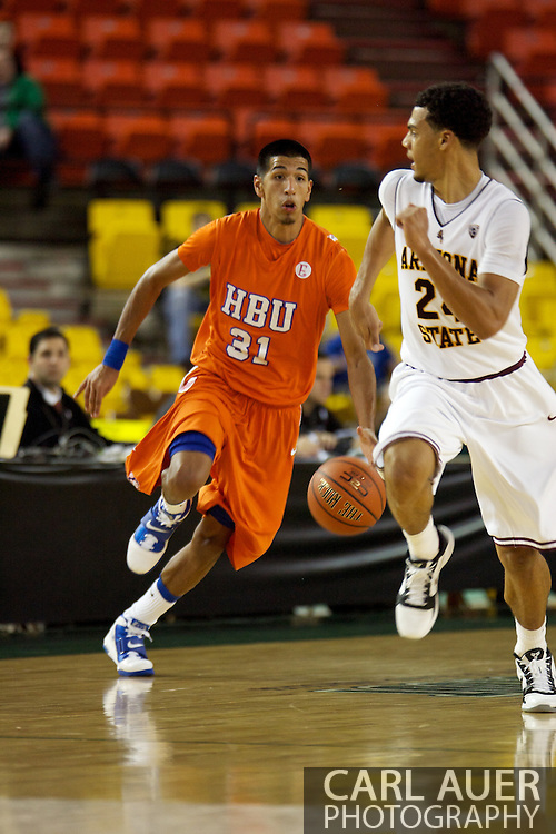 November 25th, 2010:  Anchorage, Alaska - Houston Baptist forward Andrew Gonzalez (31) brings the ball up the court in the Huskies 55-73 loss to Arizona State at the Great Alaska Shootout.  Gonzalez led all scorers with 26 points.