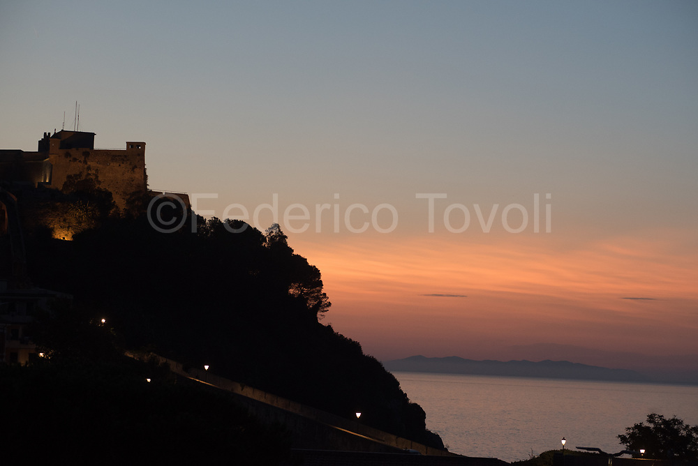 Portoferraio. Le Viste beach at dusk with Falcone fort's silhouette