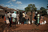 People displaced by the war between the government of Sri Lanka and the LTTE collect water in a camp for internally displaced people at the Menick farm near Vavuniya, Sri Lanka on July 8, 2009. Nearly 300,000 people remain in camps after the war as the government works on resettling them and screening for remaining LTTE members.
