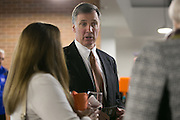Men's hockey coach Wayne Wilson speaks with guests at the dedication ceremony for the Gene Polisseni Center at RIT on Thursday, September 18, 2014.