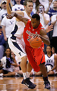 during the first half of an NCAA basketball game, Dec. 11, 2010 in Salt Lake City. (AP Photo/Colin E Braley)