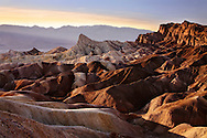 The Setting Sun Casts Oblique Light On Zabriskie Point, Death Valley National Park, California, USA