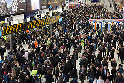 © Licensed to London News Pictures. 22/12/2015. London, UK. Crowds of people waiting for trains at London Waterloo Station this evening. Today is the start of the annual festive Christmas getaway, which combined with last minute shopping and regular commuting is expected to lead to packed trains and congested roads across the country. Photo credit : Vickie Flores/LNP