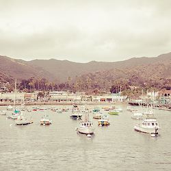 Catalina Island retro panorama picture of Avalon Bay California with hillside buildings, businesses, and boats. Santa Catalina Island is part of Southern California in the United States and is a popular travel vacation destination.
