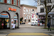 """A """"Smash WEF"""" grafitti on a wall. Zurich is by far the biggest city in Switzerland, with a population near 1.83 million in the metropolitan area. It is also the finacial center in Switzerland."""
