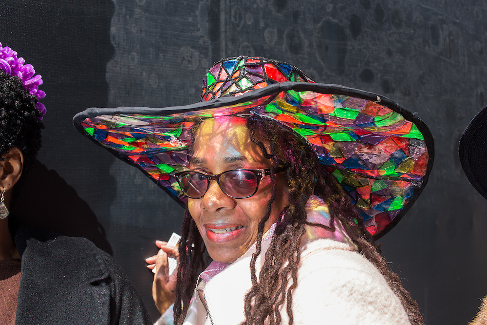 New York, NY, USA-27 March 2016. Milliner Wanda J. Chambers wears one of her hats, which looks like a wide-brimmed western hat made of bits of stained glass, on Fifth Avenue in the annual Easter Bonnet Parade and Festival. Ms. Chambers, who owns the Once Upon a Hat shop, was there with a group from the Milliners Guild.