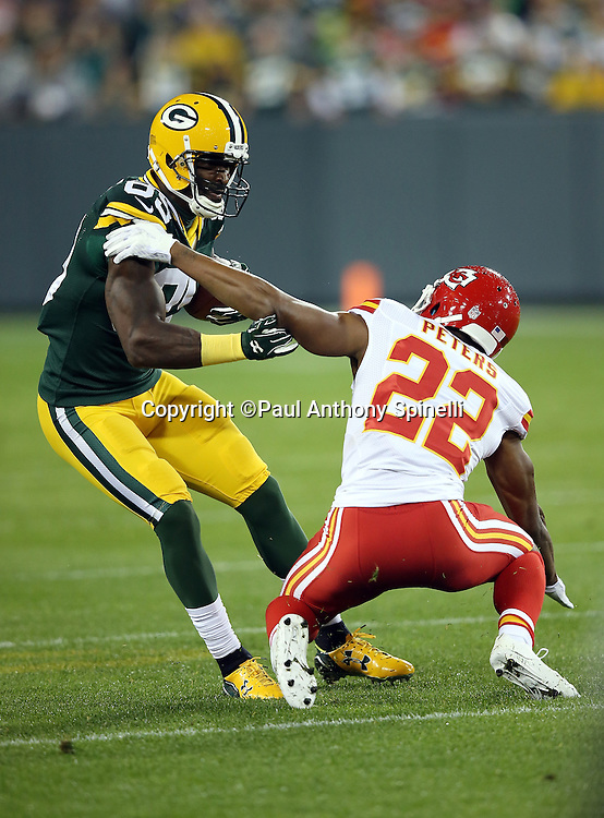 Green Bay Packers wide receiver James Jones (89) tries to break away from a tackle attempt by Kansas City Chiefs cornerback Marcus Peters (22) as he catches a flat pass good for a gain of 12 yards and a first down in the first quarter during the 2015 NFL week 3 regular season football game against the Kansas City Chiefs on Monday, Sept. 28, 2015 in Green Bay, Wis. The Packers won the game 38-28. (©Paul Anthony Spinelli)