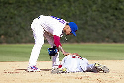 August 17, 2017 - Chicago, IL, USA - Chicago Cubs second baseman Javier Baez checks on the Cincinnati Reds' Phillip Ervin after he was hit with the ball during the ninth inning at Wrigley Field in Chicago on Thursday, Aug. 17, 2017. The Reds won, 13-10. (Credit Image: © Armando L. Sanchez/TNS via ZUMA Wire)
