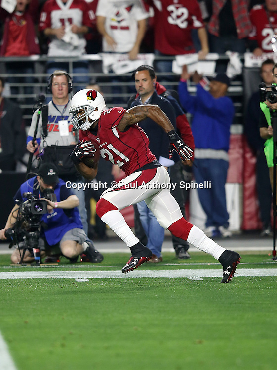 Arizona Cardinals cornerback Patrick Peterson (21) returns a second quarter for an apparent touchdown negated by a second quarter penalty during the NFL NFC Divisional round playoff football game against the Green Bay Packers on Saturday, Jan. 16, 2016 in Glendale, Ariz. The Cardinals won the game in overtime 26-20. (©Paul Anthony Spinelli)