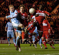 Photo: Jed Wee.<br /> Middlesbrough v Coventry City. The FA Cup. 08/02/2006.<br /> <br /> Coventry's Andy Whing (L) is crowded out in the Middlesbrough penalty area.