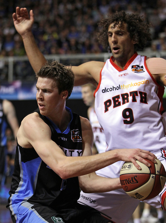 Breakers' Thomas Abercrombie is blocked by Wildcats' Matthew Knight in round 1 of an ANBL Basketball Match, North Shore Events Centre, Auckland, New Zealand, Friday, October 05, 2012.  Credit:SNPA / David Rowland