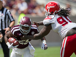 Louisiana-Lafayette defensive tackle Kevon Perry (90) wraps up Texas A&M running back Kendall Bussey (25) for a loss during the third quarter of an NCAA college football game Saturday, Sept. 16, 2017, in College Station, Texas. (AP Photo/Sam Craft)